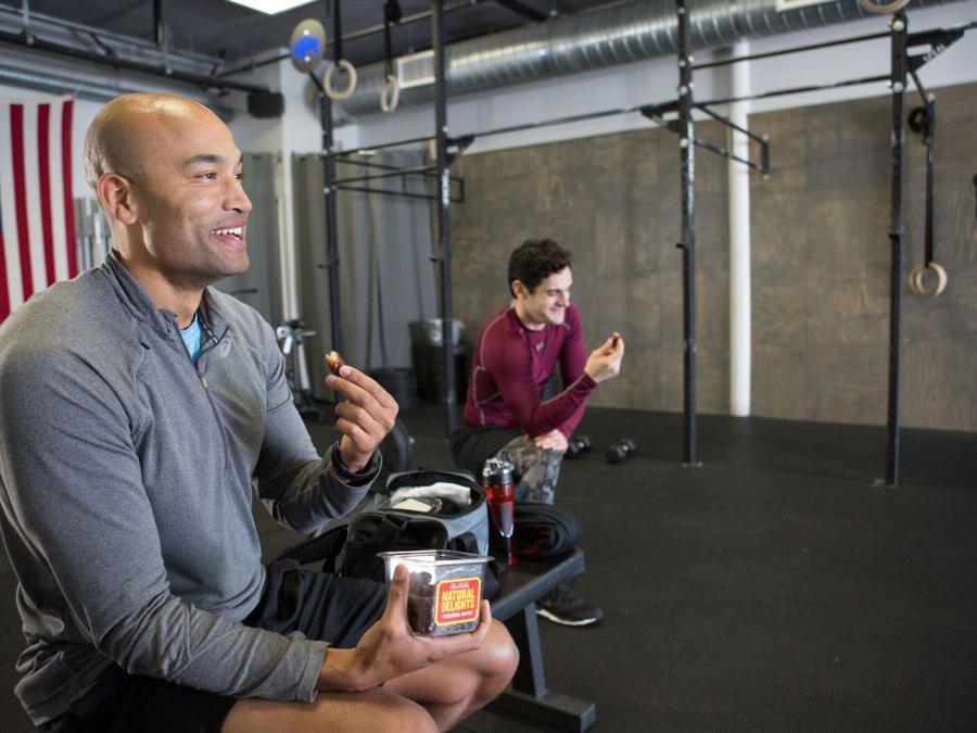 Man at gym eating dates