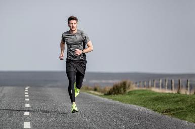 Man Running on Road