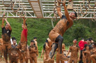 Man swinging on rings during Spartan Race