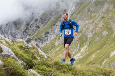 Man running ultramarathon on mountain