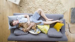 Man Sleeping On Couch With Dog