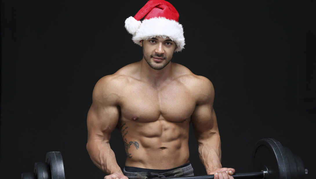 Barbell curl with Christmas hat