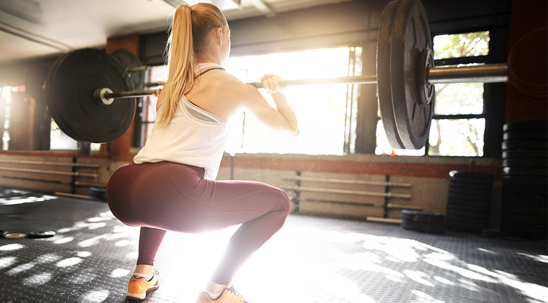 Woman Does Barbell Squat