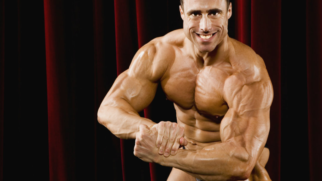 bodybuilder flexing arm