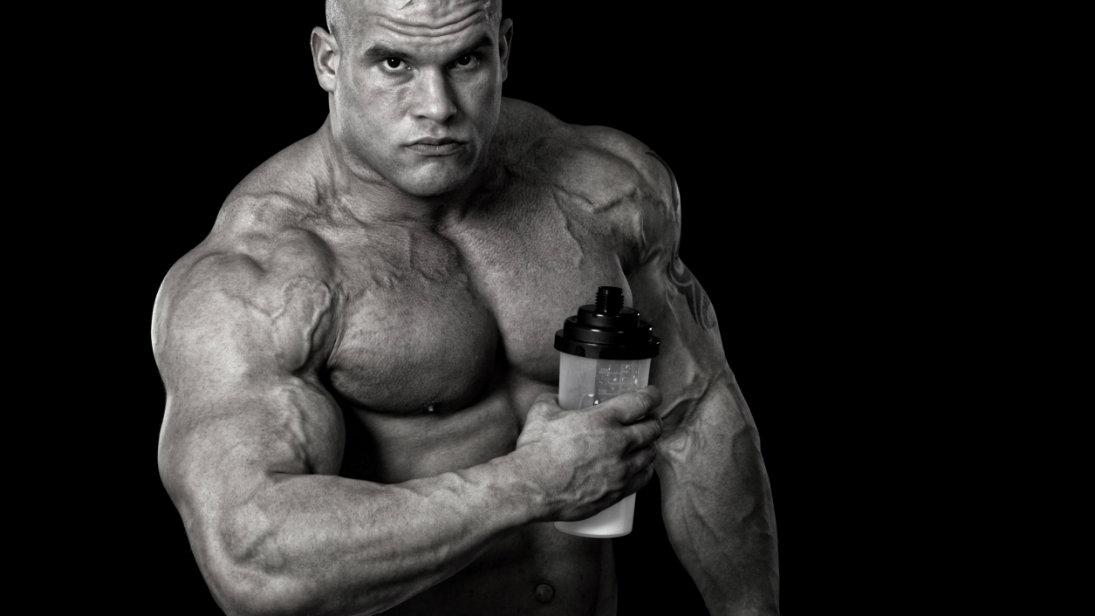 man holding protein drink