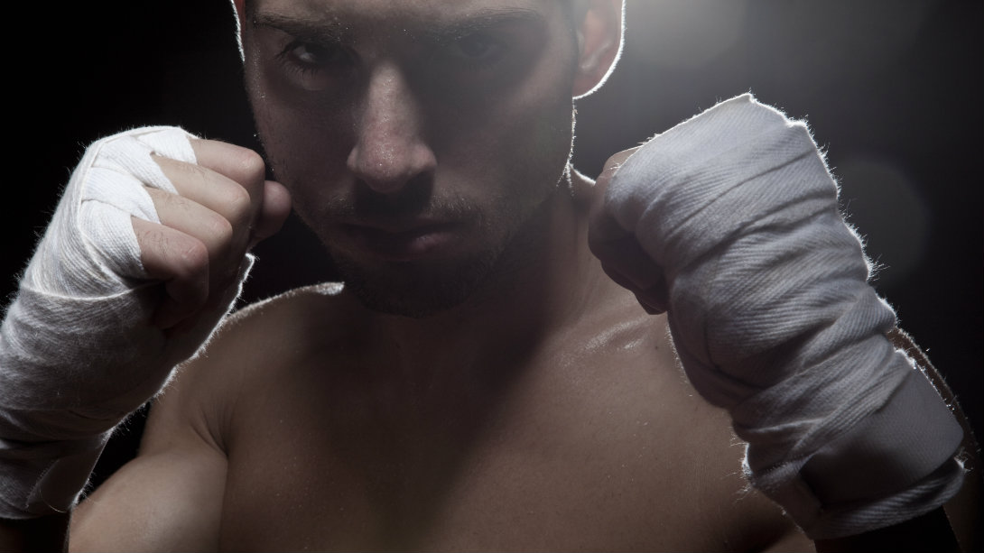 fighter with hands wrapped