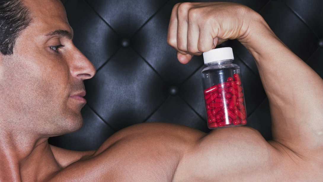 man with supplement bottle