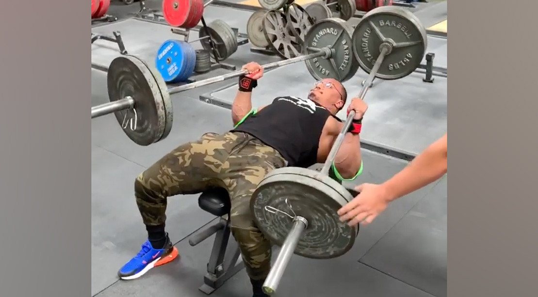 Watch Larry Wheels Bench Two 225-Pound Barbells for His Birthday