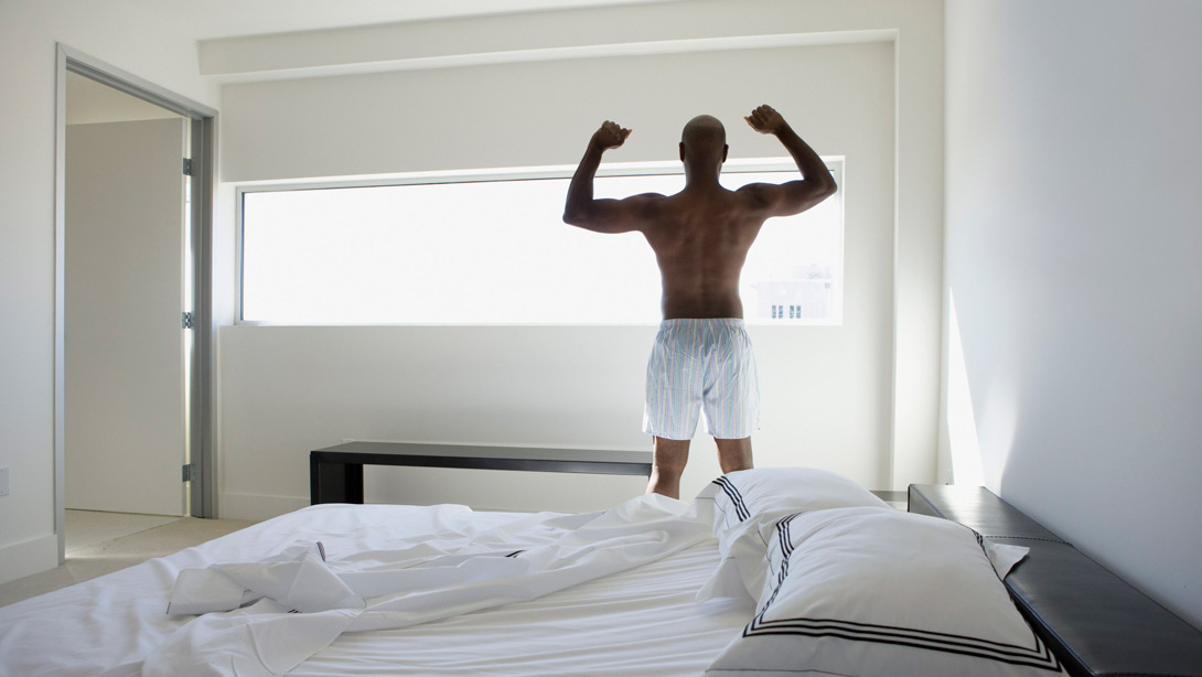 man waking up stretching