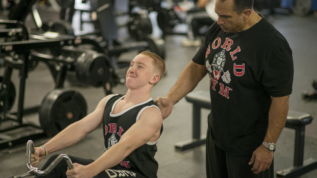Jake with trainer during row exercise