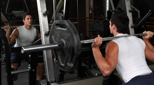 barbell squat in mirror