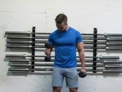 Man Performing Standing Dumbbell Curl thumbnail