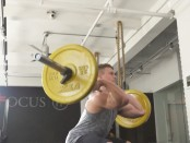 Man performs barbell thruster exercise thumbnail