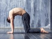 Man does cat yoga pose thumbnail