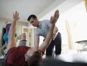 Fit man doing dead bug exercise thumbnail
