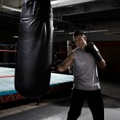 Boxer working on heavy bag thumbnail