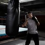 Boxer working on heavy bag thumbnail