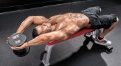 Muscular-Topless-Male-Performing-Lying-Dumbbell-Pullover-End-Position thumbnail