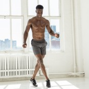 Man doing cross tuck jump exercise.  thumbnail