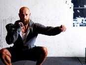 Man does single-arm kettlebell thruster exercise thumbnail