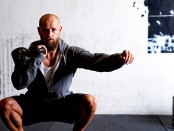 Man does single-arm kettlebell thruster exercise thumbnail