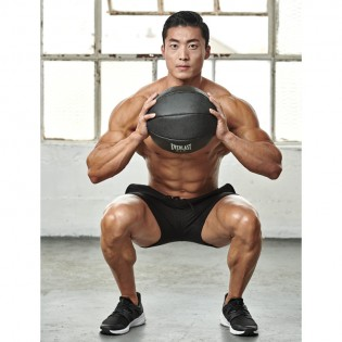 How to Do a Medicine Ball Squat to Overhead Press | Muscle & Fitness