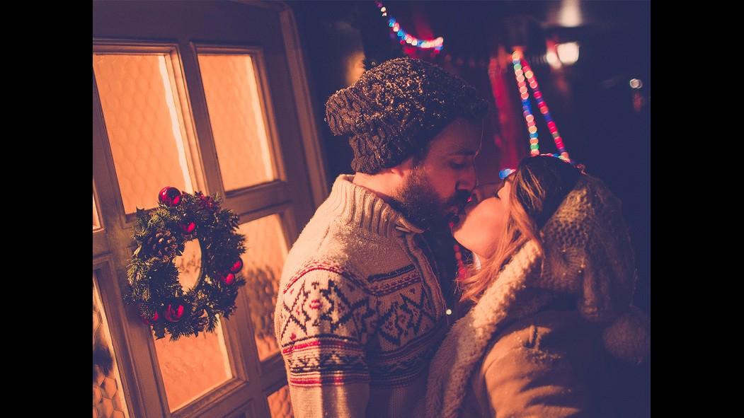Couple Kiss Under the Mistletoe thumbnail