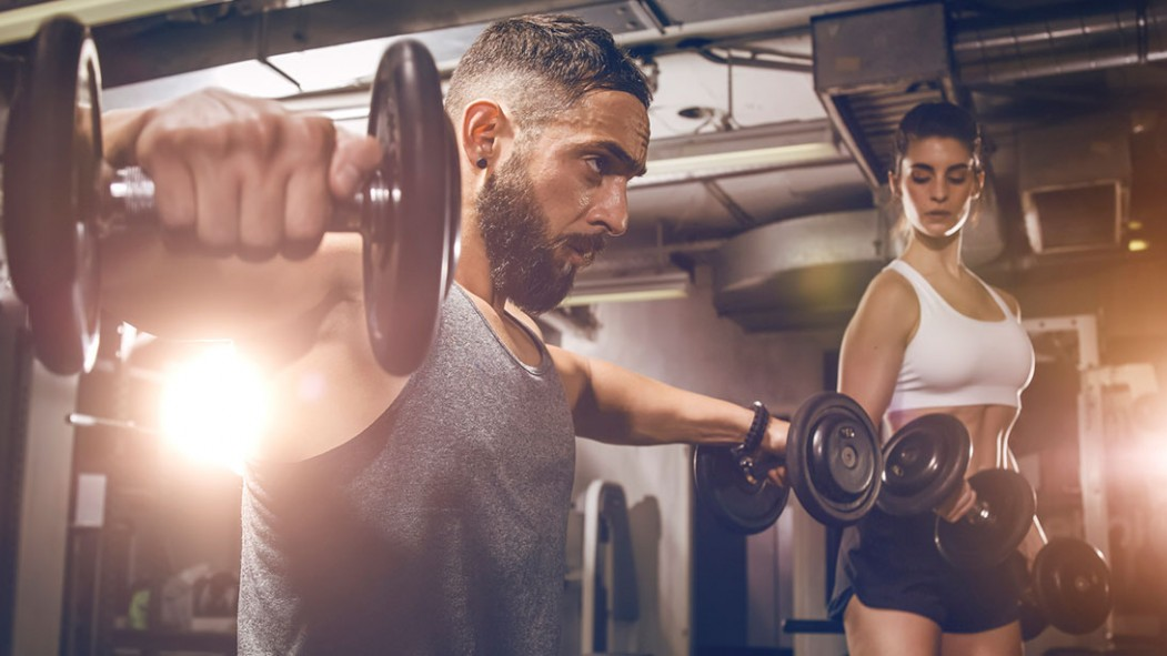 Man and Woman Training with Dumbbells thumbnail