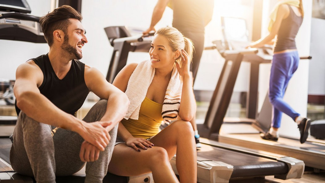 Man and woman flirting at gym thumbnail