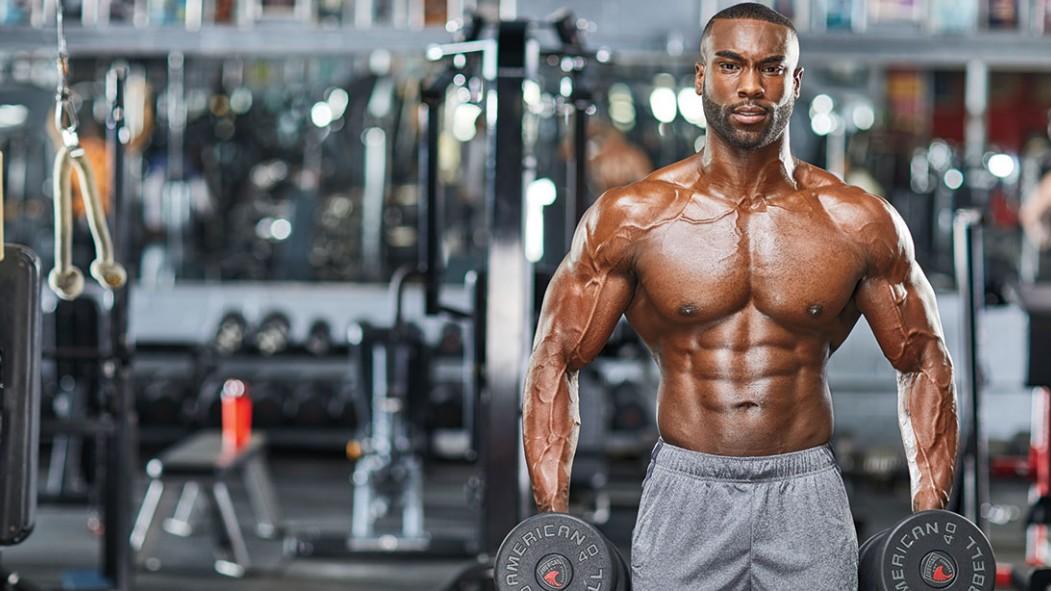 Bodybuilder holding dumbbells thumbnail