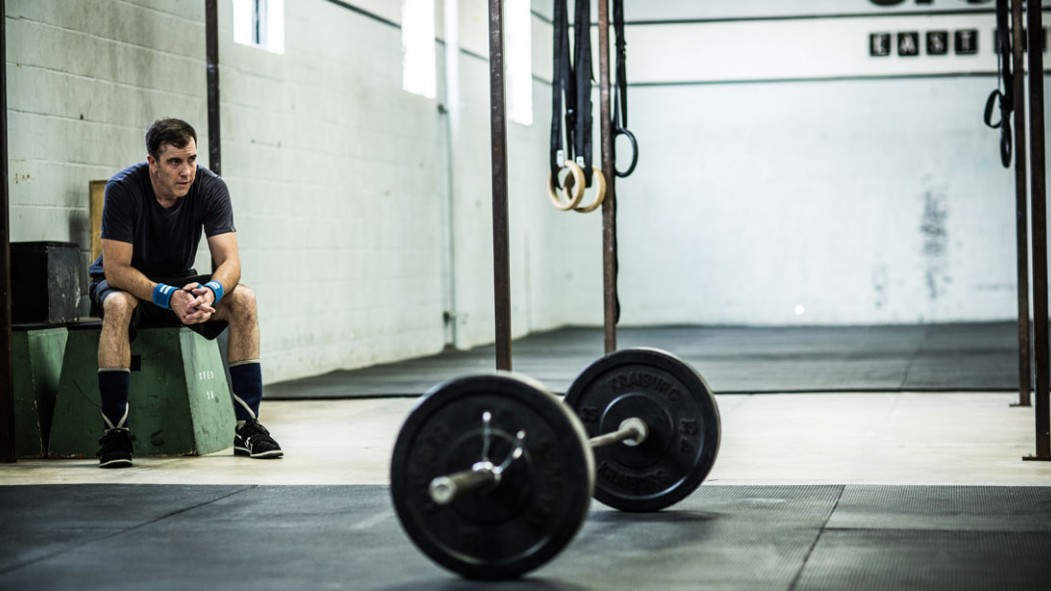 Man Tired, Resting In The Gym With Barbell thumbnail