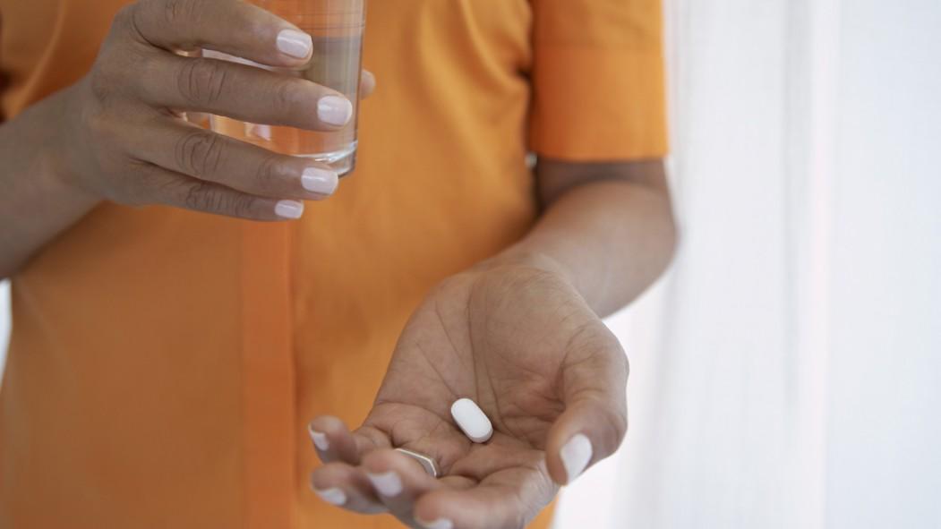 Woman Taking Pill thumbnail