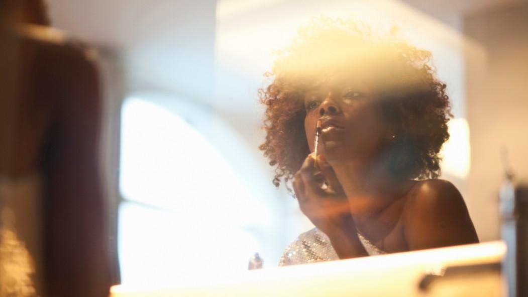 Woman Applying Lipstick thumbnail