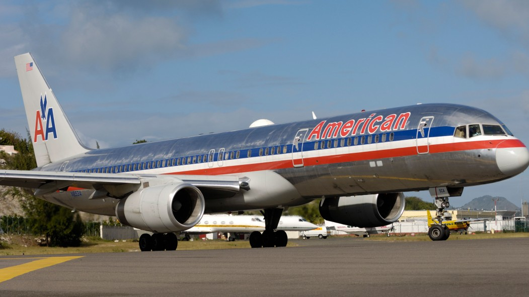 An American Airlines flight forced to land early due to passenger doing pull ups  thumbnail
