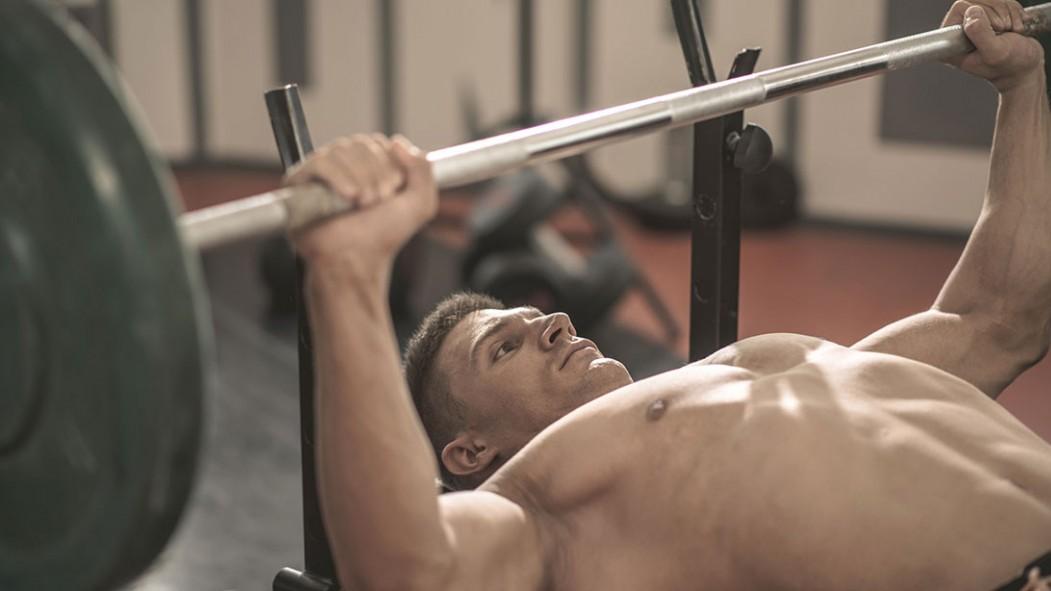 A man bench pressing thumbnail