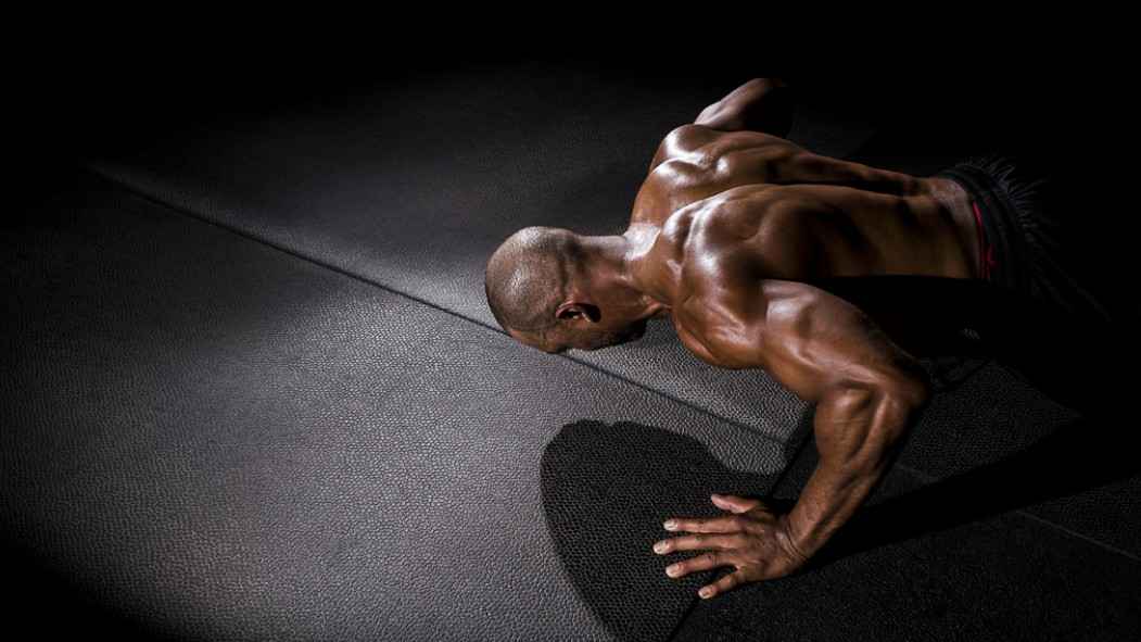 Black-Man-Doing-Pushup-In-Dark-Room thumbnail