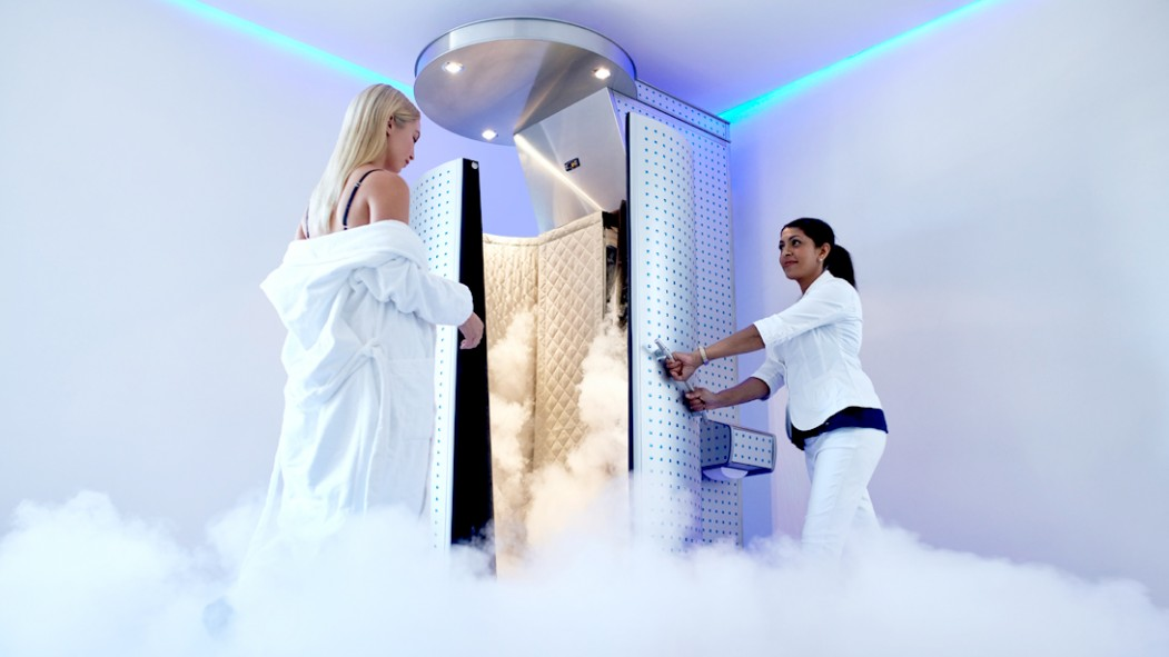 Blonde-Female-Derobing-Entering-Cryotherapy-Chamber thumbnail