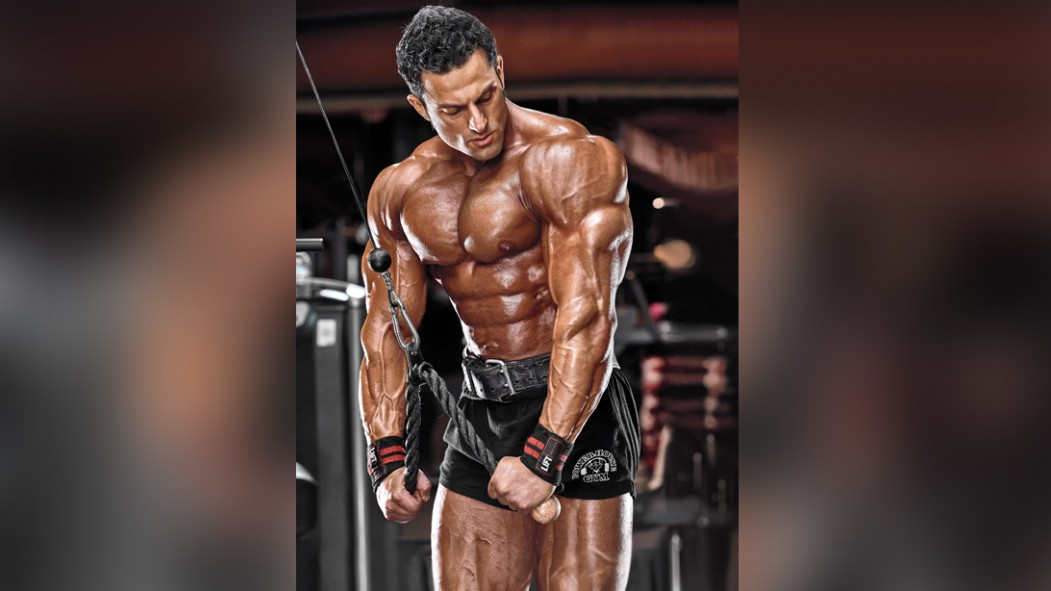 Bodybuilder performing cable triceps pressdown thumbnail
