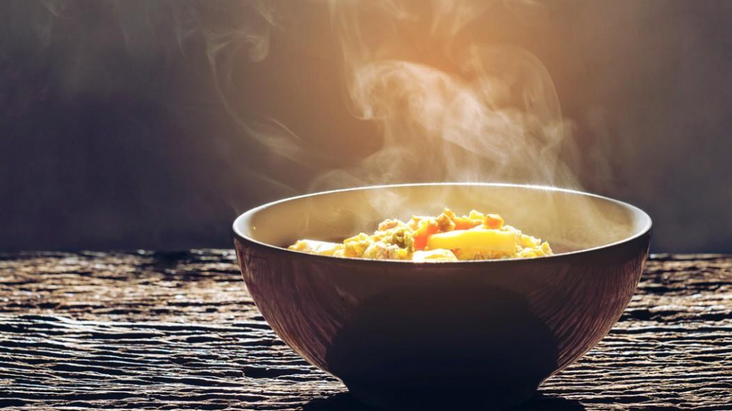Bowl-of-Soup-On-Wooden-Table-Smokey thumbnail