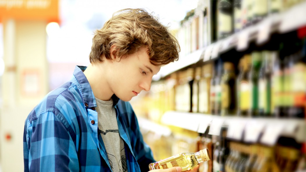 College-Student-Looking-At-Food-Label thumbnail