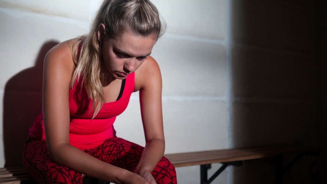 Depressed-Fitness-Girl-Sitting-On-Bench-Shadows thumbnail