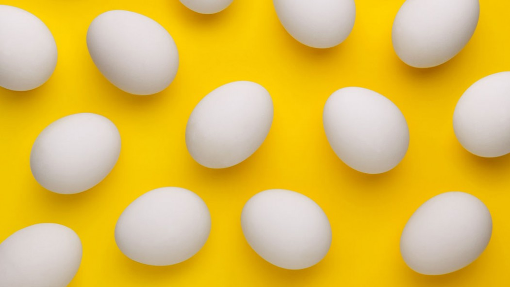 A photo of eggs against a yellow background. thumbnail