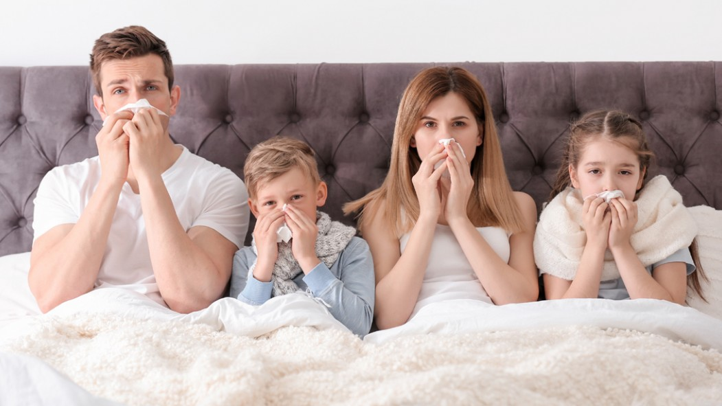 Family-Sick-In-Bed-Blowing-Noses-With-Kleenex-Tissue thumbnail
