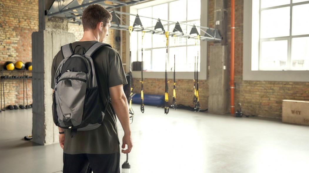 Fit-Person-Entering-Empty-Crossfit-Gym thumbnail