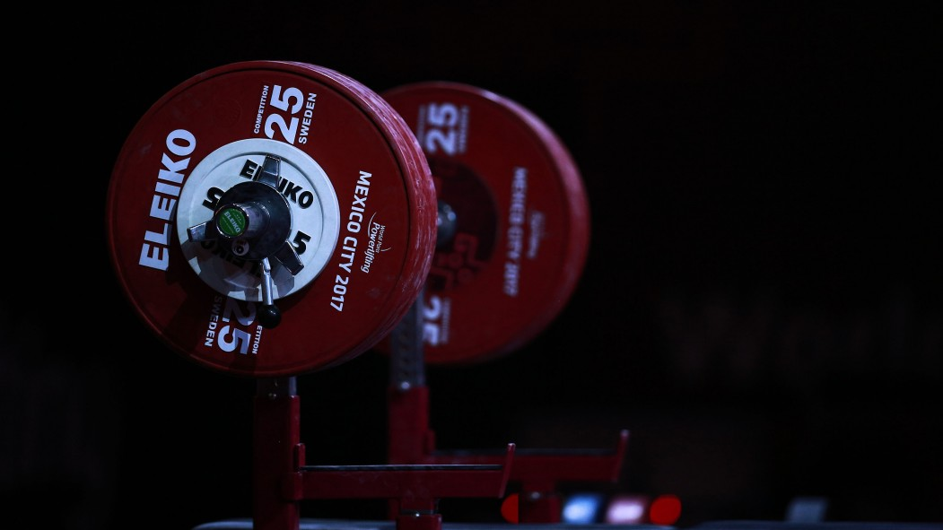 A barbell loaded with weight thumbnail