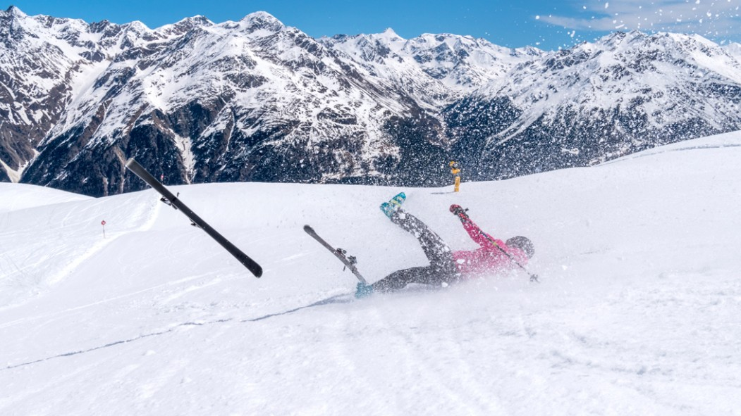 Girl-Falling-On-Ski-Skiis-Flying-in-Air. thumbnail