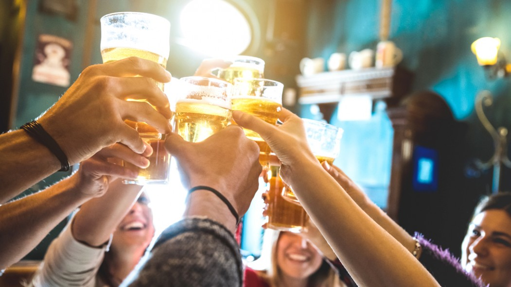 Group-Of-Friends-Cheering-With-Glass-Of-Beer thumbnail