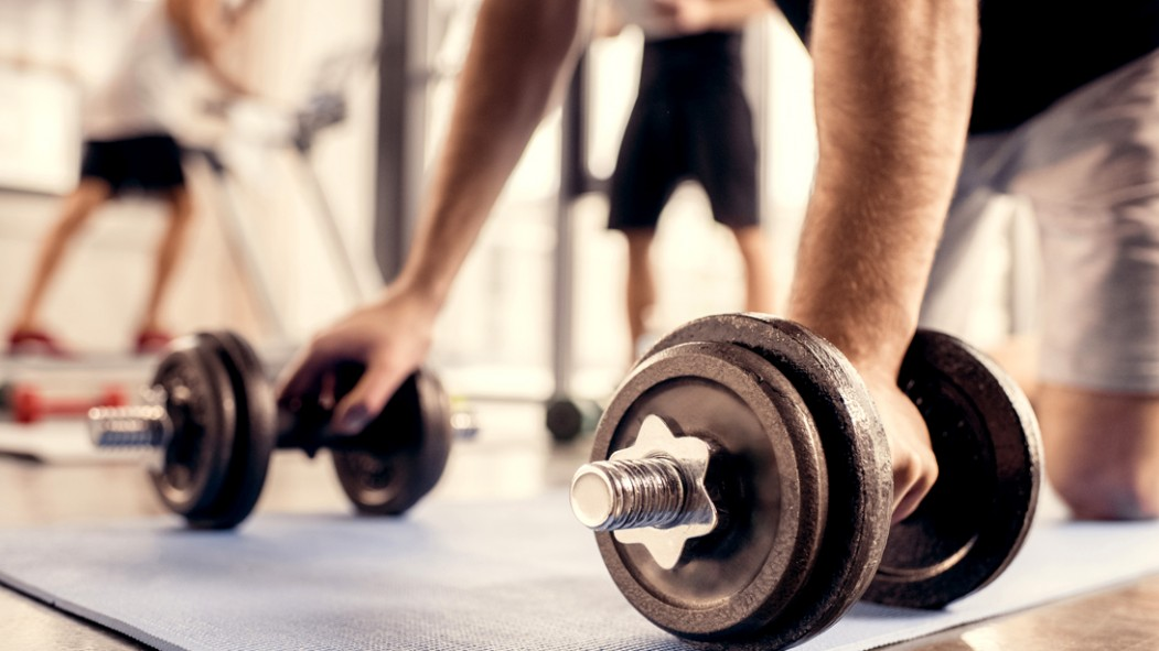 Man-Bent-Over-On-Mat-Grabbing-Adjustable-Dumbbell-Weights thumbnail