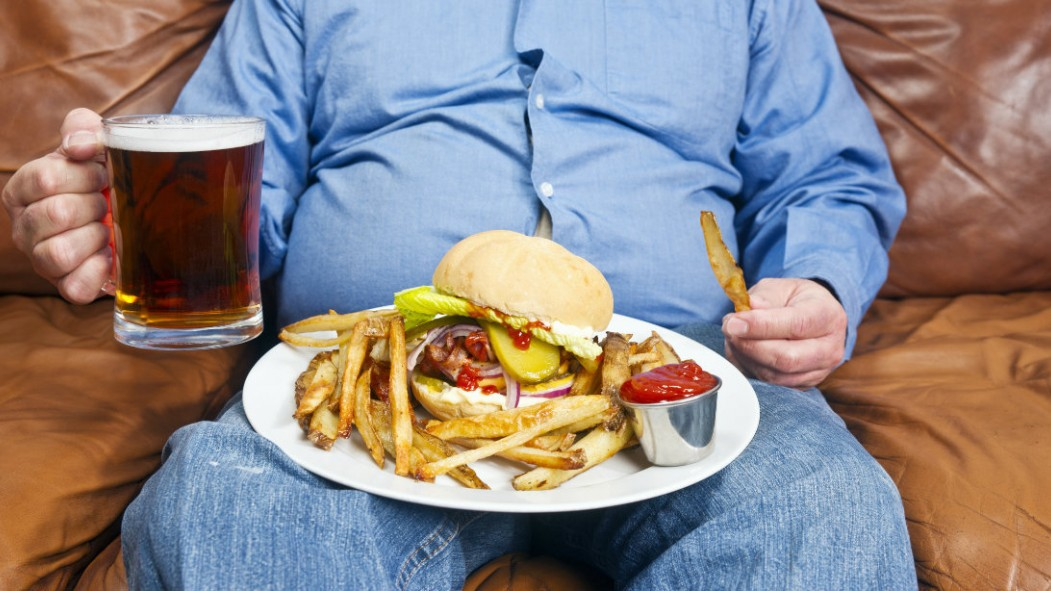 Seated Man With Plate of Food and Beer thumbnail