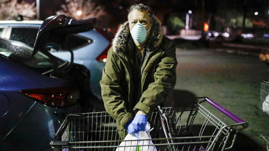 Man-Wearing-Mask-From-Coronavirus-While-Putting-Groceries-In-Trunk thumbnail